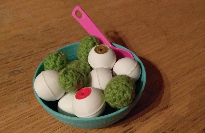 bowl with eyeballs and crochet peas