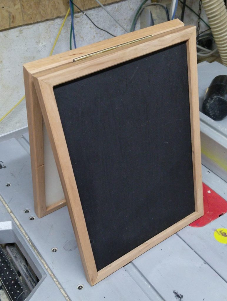 foldable blackboard, standing on a table saw